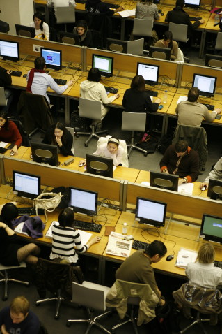 Students studying at IT workstations in the open plan facilities on the lower ground floor of the British Library of Political and Economic Science
